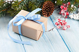 Christmas gift box and tree branch