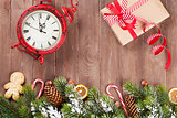 Christmas background with tree, alarm clock and gift