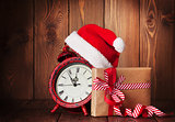 Christmas gift box, alarm clock and santa hat