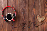 Heart toy with headphones and coffee cup