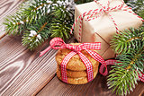 Christmas gingerbread cookies, gift and tree branch