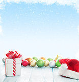 Christmas gift box, santa hat and colorful baubles