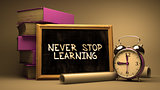 Never Stop Learning Handwritten by white Chalk on a Blackboard.