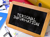 Personal Information Handwritten on Chalkboard.