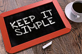 Keep It Simple Handwritten on Chalkboard.