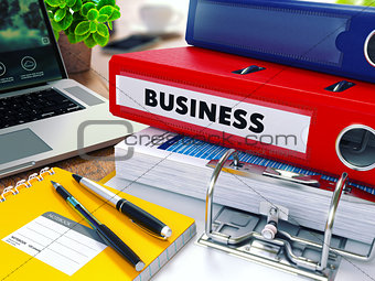 Business on Red Ring Binder. Blurred, Toned Image.
