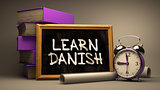 Hand Drawn Learn Danish Concept on Chalkboard.