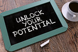 Hand Drawn Unlock Your Potential Concept on Chalkboard.