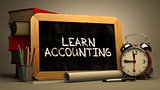 Hand Drawn Learn Accounting Concept on Chalkboard.
