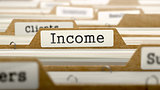 Income Concept with Word on Folder.