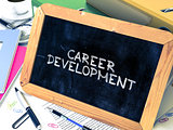 Career Development Handwritten by white Chalk on a Blackboard.