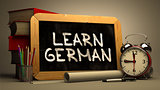 Learn German Concept Hand Drawn on Chalkboard.