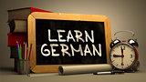 Learn German Concept Hand Drawn on Chalkboard.