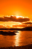 wild atlantic way ireland with an orange sunset