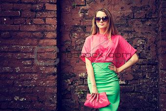 Beautiful Fashionable Woman at the Brick Wall