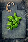 vintage cutting board and fresh basil