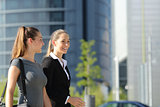 Businesswomen walking and talking in the street