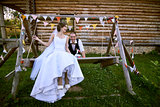 Newlyweds on swing.