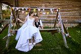 Newlyweds on swing.