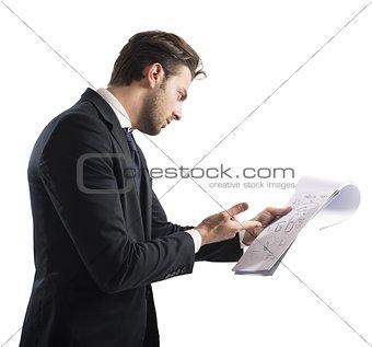Businessman analyzes profit
