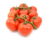 Ten red tomatoes on the vine
