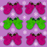 pattern with decorative ornamented mittens on purple background with snowflakes