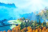 Autumn misty morning mountainside