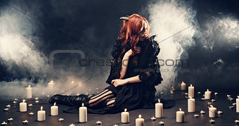 Beautiful witch making the witchcraft o