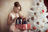 elegant girl with xmas gifts
