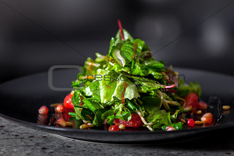 appetizer with herbs and pomegranate seeds