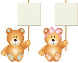 Baby teddy bears boy and girl holding a signboards