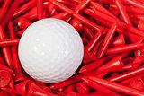 White golf ball lying between wooden tees