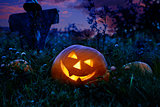 Halloween pumpkin and rustic scarecrow  at night