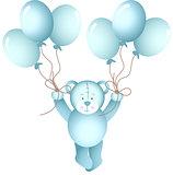 Baby boy teddy bear flying holding a balloons
