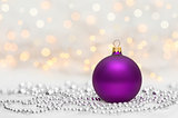 Purple Christmas ball with metallic beads