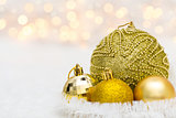 Golden Christmas balls on white