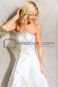 beautiful sensual bride on background wall