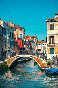 Bridge over channel among houses in Venice