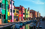 Bright coloured houses on coast of channel in Burano island