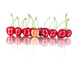 ripe cherries with reflection on isolated white background