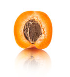 apricot half with reflection on isolated white background