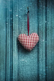 Christmas heart ornament hanging on door