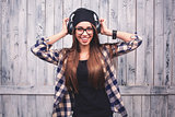 girl in glasses, headphones and black beanie