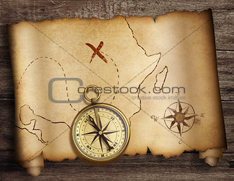 treasure map roll with old compass on table top view