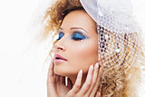 Fashionable woman with bright blue makeup