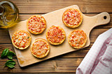 mini pizza on cutting board