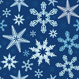 Vector Seamless illustration of white snowflakes on a blue backg