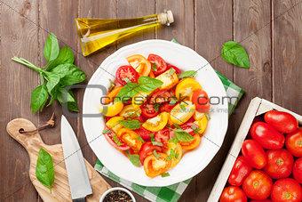 Fresh colorful tomatoes and basil salad
