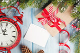 Christmas greeting card over wooden background