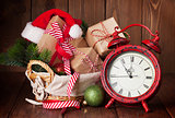 Christmas gifts and tree with alarm clock